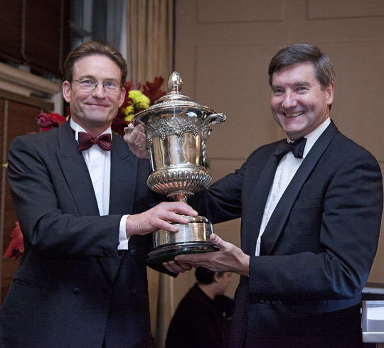 Peter Bradnock (right) is to retire after 20 years in the poultry industry. He is pictured here receiving his poultryman of the year award from BPC chairman, John Reed.