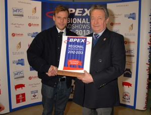 Charlie Shaw is awarded his title by BPEX's Keith Fisher.