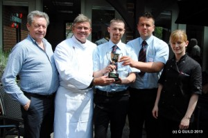 L-R: Judges Keith Fisher, Jeremy Fowler present Cranstons Butchers with their Sausage Trophy, together with judge ???