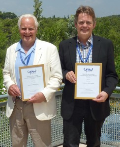 Professor John Webster (left) and Professor Peter Sandøe who each were awarded a UFAW Medal at the UFAW International Symposium in Barcelona.