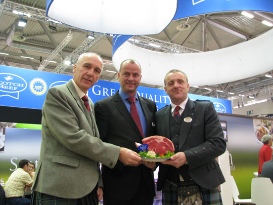 A new German customer for Scotch beef, Norbert Kunz of Recke Fleischwaren, is joined by Uel Morton, QMS Chief Executive (left) and Jim McLaren, QMS Chairman (right) on the QMS stand at Anuga, Cologne.