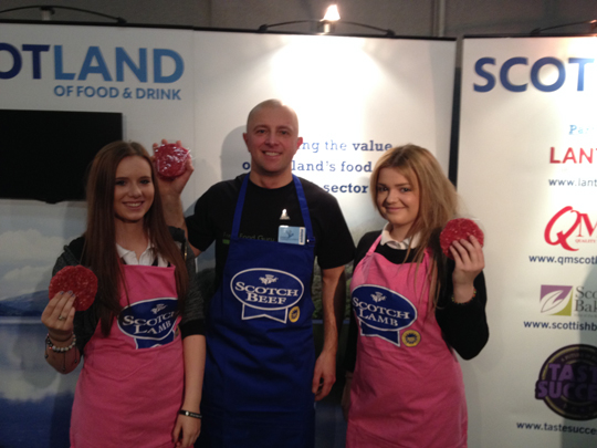 Aberdeen-based butcher Andrew Gordon pictured with Ellon Academy pupils, Toni Skene (left) and Cara Johnston at the Skills Scotland event.