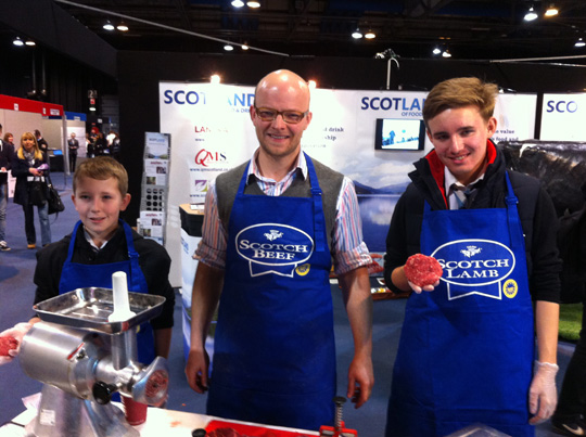 Top Glasgow butcher Alex Christie (centre) pictured making Scotch Beef burger with Cumbernauld High School pupils Ross Henderson and Andrew Barr.