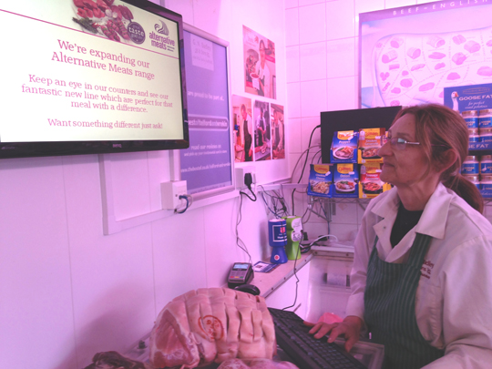 Kay Badley in the shop in Trench demonstrating part of their new 'app'roach to traceability