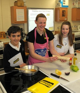 Fiona is joined by Kemnay Academy pupils Matthew Cassidy and Amy Stewart after the cookery demonstration.