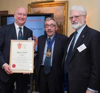 Graham Yandell (far left) receiving his Fellowship of the IOM.