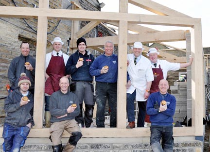 Builders and other local contractors grab a pie break, as the new extension at J Brindon Addy Butchers take shape. Brindon Addy is pictured third from left, with main contractor Iain Slater to Brindon's right. The two other butchers are Adam Shaw, left, and Joe Brereton.