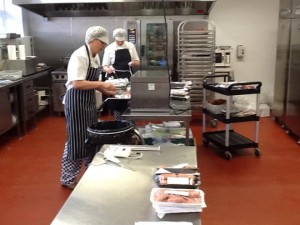Home economists prepare food for judges at the MM Awards product judging.