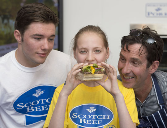 Eve Cattanach of St Mungo's High School, Falkirk was the winner of the Scotch Butchers Club Commonwealth Burger competition. Eve is pictured here with Max Murphy and butcher Rod Gillie from Thomas Johnston in Falkirk.