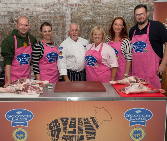 L-R: Master butcher Viv Harvey and celebrity chef Jak O'Donnell are joined by the group of European food bloggers at the Scotch Lamb Street Food Festival.