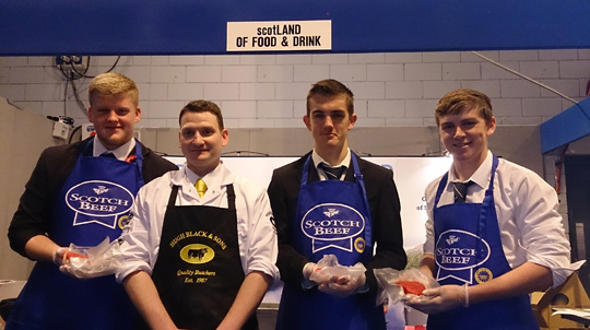 L-R: Jamie Shields, Lewis Boyd and Andrew Taylor from Park Mains High School, Renfrewshire, join butcher John Harvey from Hugh Black & Sons and proudly show off their burgers which they made at the Skills Scotland event.