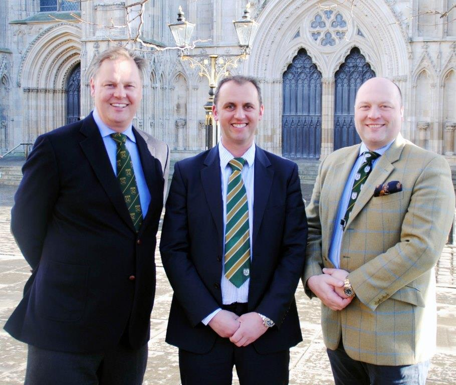 Alnwick butcher Mark Turnbull, centre, newly appointed chairman of the national Butchers Q Guild, is congratulated by outgoing chairman Brindon Addy, joined by new national vice-chairman David Lishman.