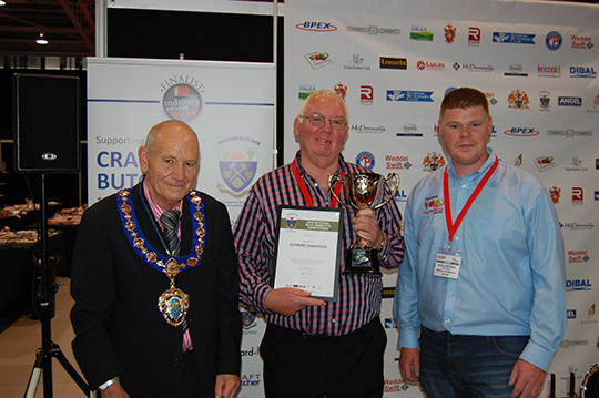 Mike Maloney (centre) with (left) NFMFT President Jim Sperring and Michael Rawsthorne of IFI Ingredients (sponsors)