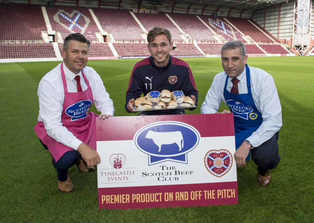 JambosÕ winger Sam Nicolson, prepares to tuck into a delicious Scotch Beef PGI roll to celebrate Heart of Midlothian Football Club becoming the first Scottish Premiership club to join Quality Meat ScotlandÕs Scotch Beef Club. Pic shows l to r: