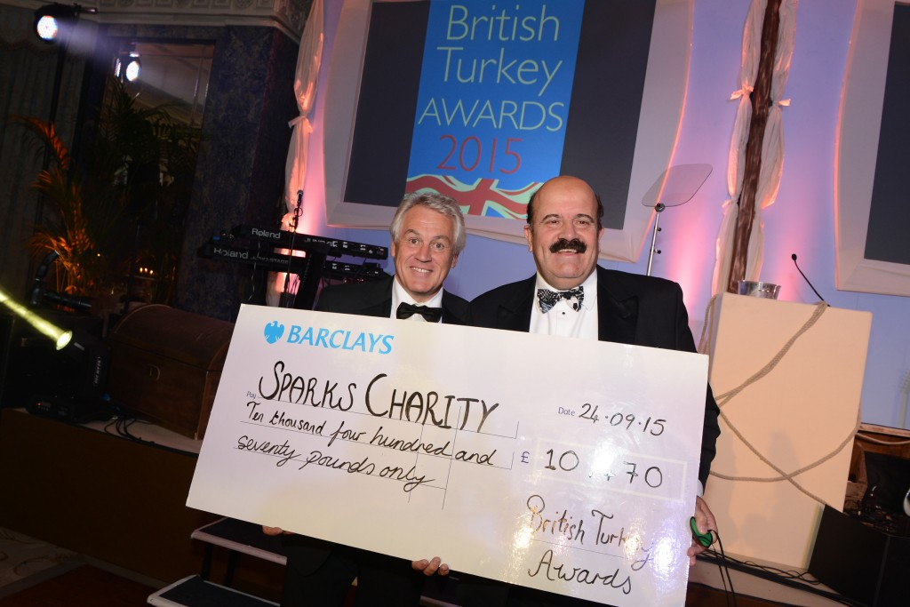 Paul Kelly, chairman of the British Turkey Federation and Willie Thorne with a cheque for £10,470 for children's charity Sparks.