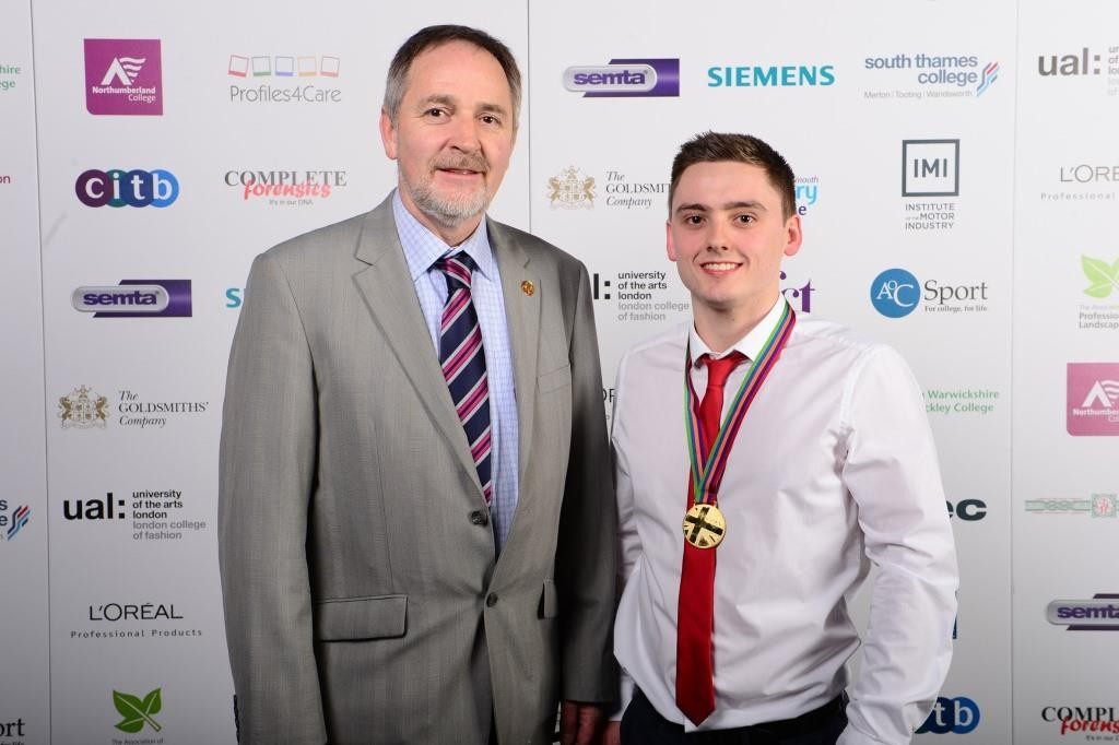 Matthew Edwards with Cambrian Training Company's managing director Arwyn Watkins after receiving his gold medal.