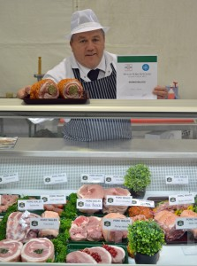Welsh Pork Butcher champion Clinton Roberts with his winning display.