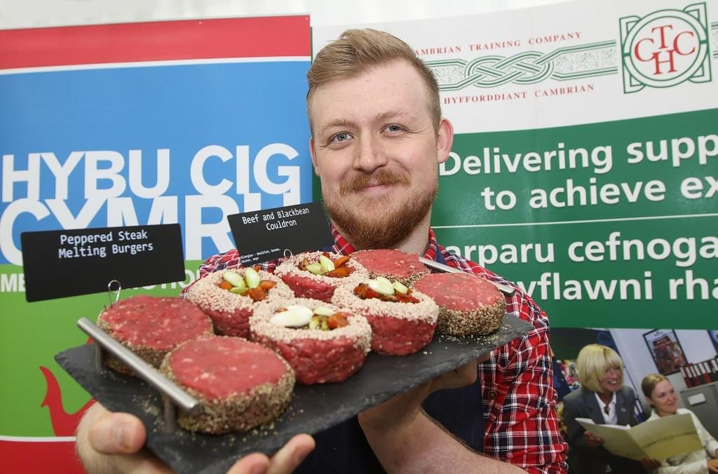 Pictured: Sam Hughes with one of the meat displays that helped him become the Welsh Young Butcher champion.