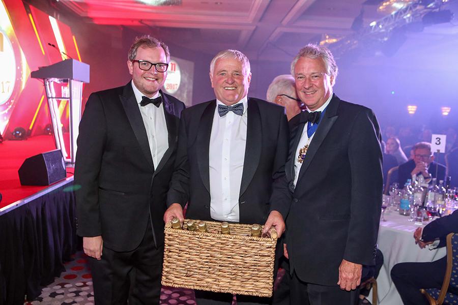 BDCI raffle winner Freddy Creedon of Simpsons Butchers (C) with Miles Jupp and WCB master Stuart Thompson.