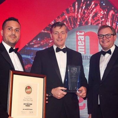 BRITAIN'S BEST FREE FROM PRODUCT – Simon Howie Foods. L-R: Category partner David Grimshaw of Coolkit, Simon Howie of Simon Howie Foods and Miles Jupp.