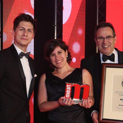 Britain's Best Burger - Host Ben Hanlin, winner Fran Barros of Walker Sausage Co and category partner Steve Derrick of Lucas Ingredients.