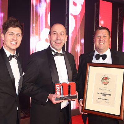 The Catering Butcher Award - Host Ben Hanlin, winner Simon Smith of Aubrey Allen Ltd and category partner Rodger Norman of Dawsongroup.