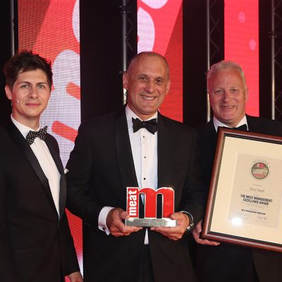 The Excellence Award - Host Ben Hanlin, winner Dave Smith of ABP and category partner Simon House of Sealed Air Food Care.