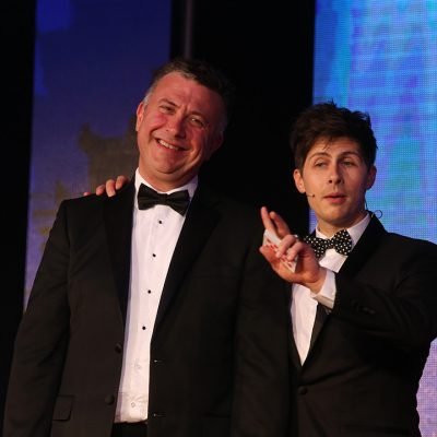 Danny Upson of Dalziel on stage with magician Ben Hanlin.