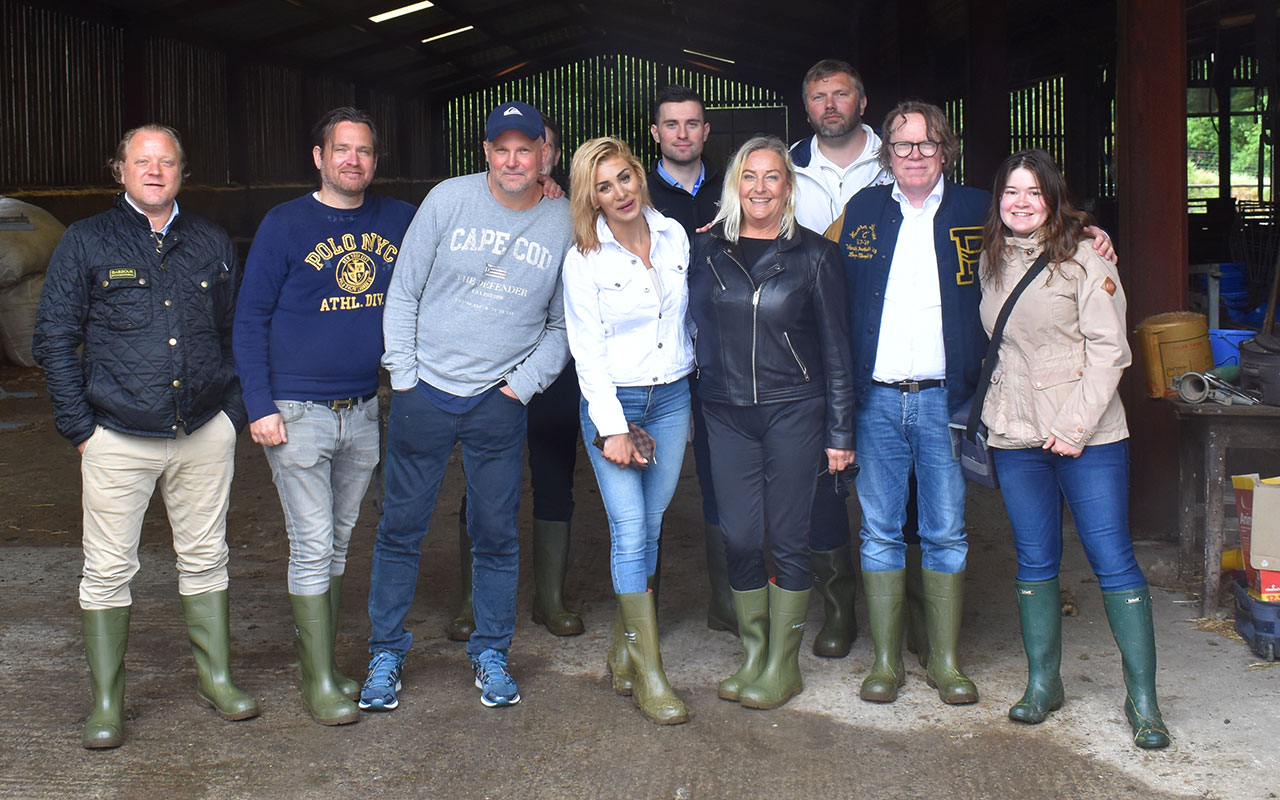 A group of Swedish journalists on a farm visit near Lampeter.