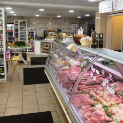 Which cities spent the most in butcher shops in 2020?